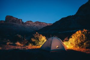 Camping in a tent outside, camp swaps
